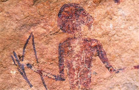 prehistoric - Libya, Fezzan, Jebel Akakus. A painted figure lies hidden on the walls of Graibu, one of Wadi Teshuinat's  caves Stock Photo - Rights-Managed, Code: 862-03731754