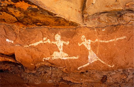 prehistoric - Libya, Fezzan, Jebel Akakus. A pair of running figures painted onto the walls of Uan Muhuggiag, one of Wadi Teshuinat's caves. Stock Photo - Rights-Managed, Code: 862-03731755