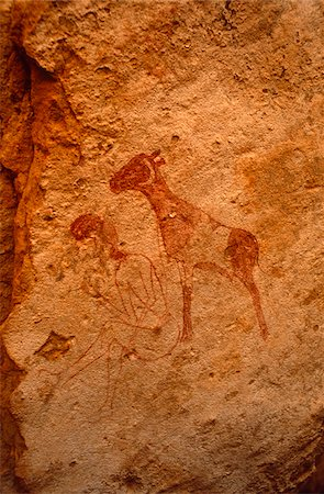 prehistoric - Libya, Fezzan, Jebel Akakus. Painted images on the walls of Uan Inehad (aka Infarden), one of Wadi Teshuinat's Stock Photo - Rights-Managed, Code: 862-03731759
