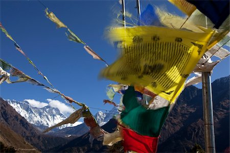 Nepal, Everest Region, Khumbu Valley. Buddhist prayer flags adorn the trail and frame Mount Everest in the background Stock Photo - Rights-Managed, Code: 862-03731940