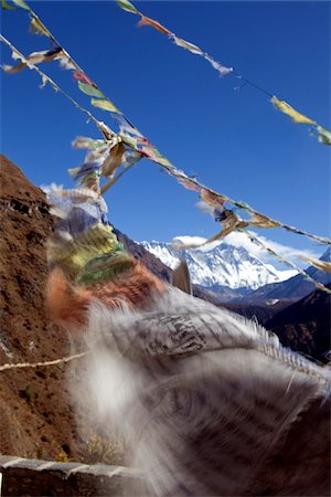 Nepal, Everest Region, Khumbu Valley. Buddhist prayer flags adorn the trail and frame Mount Everest in the background Stock Photo - Rights-Managed, Code: 862-03731941