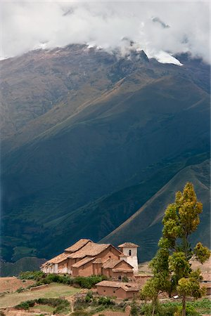Peru. A farmhouse and outbuildings dwarfed by snow-capped mountains near Moras. Stock Photo - Rights-Managed, Code: 862-03732042