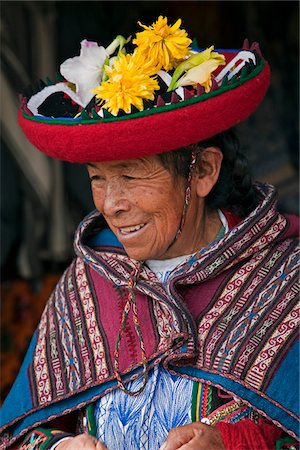 peru and culture - Peru, An old woman in traditional Indian costume with her round, saucer-shaped hat decorated with fresh flowers. Stock Photo - Rights-Managed, Code: 862-03732053