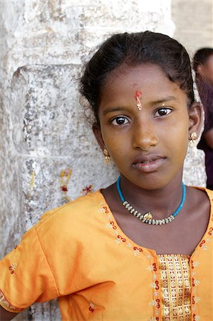 India, Tamil Nadu. Portrait of an Indian girl at the Minakshi Sundareshvara Temple. Stock Photo - Rights-Managed, Code: 862-03807495