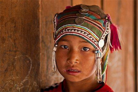 Myanmar, Burma, Kengtung (Kyaing Tong). Young Akha girl, in a hill village near Kengtung. Stock Photo - Rights-Managed, Code: 862-03807979