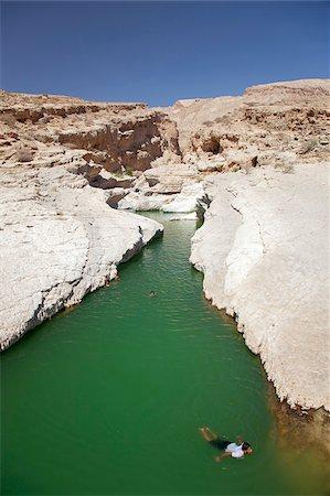 Oman, Wadi Bani Khalid. Children swim in the clear, fresh waters of Wadi Bani Khalid. Stock Photo - Rights-Managed, Code: 862-03808147