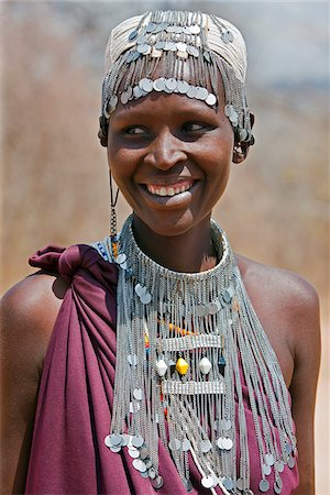 A Maasai girl from the Kisongo clan wearing an attractive beaded headband and necklace. Stock Photo - Rights-Managed, Code: 862-03808715