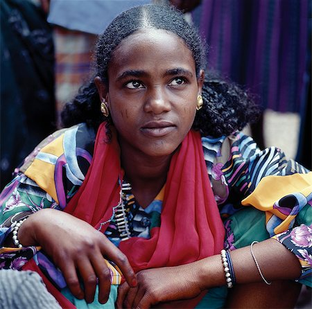 An attractive woman at Bati market.Situated on top of the western scarp of the Abyssinian Rift, Bati is the largest open air market in Ethiopia.Nomads and their camels trek long distances every week from the harsh low lying deserts to barter with Amhara and Oromo farmers living in the fertile highlands. Stock Photo - Rights-Managed, Code: 862-03820387