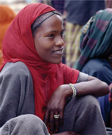 An attractive woman at Bati market.Situated on top of the western scarp of the Abyssinian Rift, Bati is the largest open air market in Ethiopia.Nomads and their camels trek long distances every week from the harsh low lying deserts to barter with Amhara and Oromo farmers living in the fertile highlands. Stock Photo - Rights-Managed, Code: 862-03820389