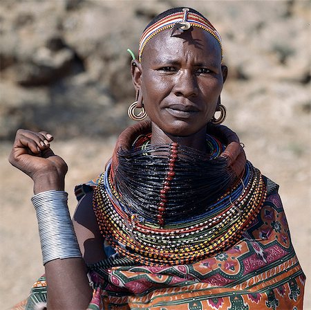 A Samburu woman wearing a mporro necklace, which denotes her married status. These necklaces were once made of hair from giraffe tails but nowadays, the fibres of doum palm fronds, Hyphaene coriacea, are used instead.The red beads after which the necklace is named are wound glass beads made in Venice c.1850. Stock Photo - Rights-Managed, Code: 862-03820646