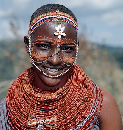 Samburu girls are given strings of beads by their fathers when they are still young. As soon as they are old enough to have lovers from the warrior age set, they regularly receive gifts from them.Over a period of years, their necklaces can smother them up to their necks. Stock Photo - Rights-Managed, Code: 862-03820650