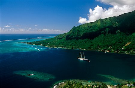 french polynesia - French Polynesia, Society Islands, Leeward Islands, Moorea, aka Aimeho. Situated behind a clearly visible reef surrounding much of the island, Opunohu Bay is a popular and stunning anchorage at Moorea. Stock Photo - Rights-Managed, Code: 862-03887688