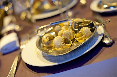 paris france cafe - A dish of escargots or snails at a cafe in Paris France Stock Photo - Rights-Managed, Code: 862-03887714