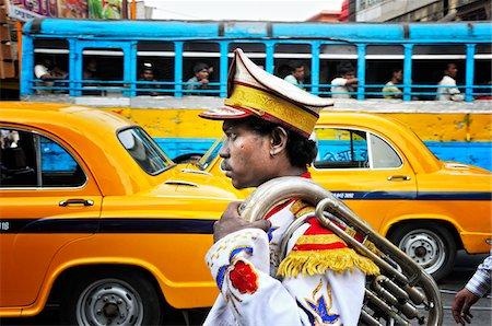 Member of a music band. Streets of Kolkata. India Stock Photo - Rights-Managed, Code: 862-03888419