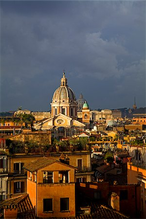 Rome, Italy; A narrowed overview of rooftops with the St.Peter's Basilica Cupola on the horizon Stock Photo - Rights-Managed, Code: 862-03888634