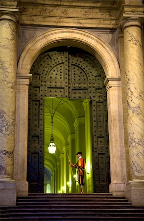 Rome, Italy; A Swiss guard at the entrance gates to the Vatican Stock Photo - Rights-Managed, Code: 862-03888644