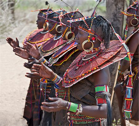 Pokot women wearing traditional beaded ornaments and brass earrings denoting their married status. celebrate an Atelo ceremony. The Pokot are pastoralists speaking a Southern Nilotic language. Stock Photo - Rights-Managed, Code: 862-03888692