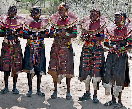 Pokot women wearing traditional beaded ornaments and brass earrings denoting their married status. celebrate an Atelo ceremony. The Pokot are pastoralists speaking a Southern Nilotic language. Stock Photo - Rights-Managed, Code: 862-03888693