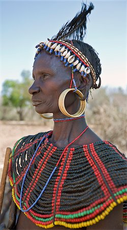 A striking old Pokot woman wearing the traditional beaded ornaments of her tribe which denote her married status. The Pokot are pastoralists speaking a Southern Nilotic language. Stock Photo - Rights-Managed, Code: 862-03888708