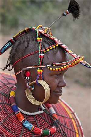 A young married Pokot woman wearing the traditional beaded ornaments of her tribe which denote her married status. The Pokot are pastoralists speaking a Southern Nilotic language. Stock Photo - Rights-Managed, Code: 862-03888700