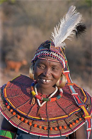 A Pokot woman wearing the traditional beaded ornaments of her tribe which denote her married status. The Pokot are pastoralists speaking a Southern Nilotic language. Stock Photo - Rights-Managed, Code: 862-03888701