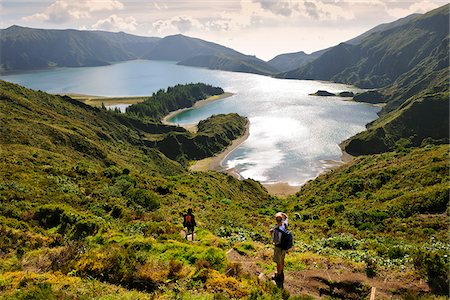 A couple walking along the big volcanic crater of Lagoa do Fogo (Fire Lagoon), a nature reserve and one of the most preserved sites in Sao Miguel. Azores islands, Portugal Stock Photo - Rights-Managed, Code: 862-03889124