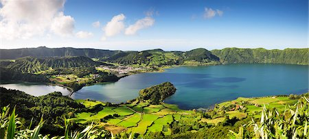 Sete Cidades volcanic lake and village. A big crater with 12 kilometers in perimeter, one of the most visited sites in Sao Miguel. Lagoa Azul & Lagoa Verde. Azores islands, Portugal Stock Photo - Rights-Managed, Code: 862-03889137