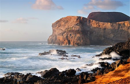 The Vulcao dos Capelinhos (Capelinhos volcano) last eruption was in 1957. It is a major attraction in Azores islands for its history, its geology and the wild beauty of the site. Faial, Azores islands, Portugal Stock Photo - Rights-Managed, Code: 862-03889156