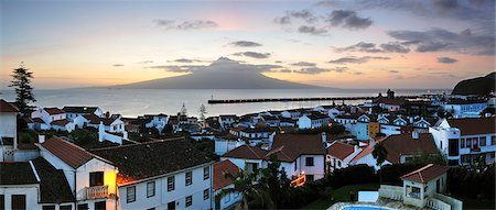 The city of Horta at dawn with the volcano of Pico island on the horizon. Faial, Azores islands, Portugal Stock Photo - Rights-Managed, Code: 862-03889158