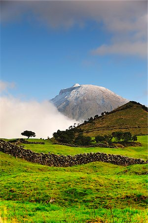 The volcano covered with snow, 2351 meters high, at the Pico island. His last eruption was in 1720. Azores islands, Portugal Stock Photo - Rights-Managed, Code: 862-03889167