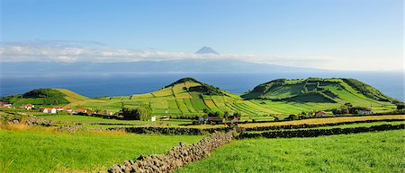 Volcanic craters along the Sao Jorge island and the Pico volcano on the horizon. Azores islands, Portugal Stock Photo - Rights-Managed, Code: 862-03889254