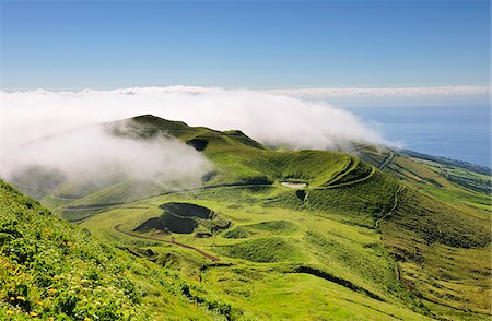Volcanic craters along the Sao Jorge island viewed from Pico da Esperanca. Azores islands, Portugal Stock Photo - Rights-Managed, Code: 862-03889258