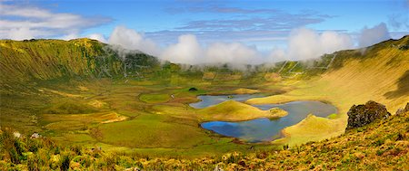 The volcanic crater (Caldeirao) with a beautiful lake on the top of Corvo island. Azores islands, Portugal Stock Photo - Rights-Managed, Code: 862-03889293