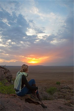 serengeti national park - Tanzania, Olduvai. A tourist enjoys the sunset looking out over the plains towards the Serengeti. Stock Photo - Rights-Managed, Code: 862-03890042