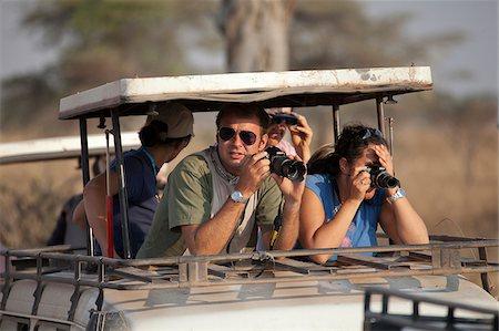 serengeti national park - Safari tourists watching game on the Serengeti in Tanzania Stock Photo - Rights-Managed, Code: 862-03890068