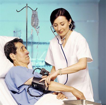 pressure - Doctor measuring blood pressure of man in hospital Stock Photo - Rights-Managed, Code: 877-06834172