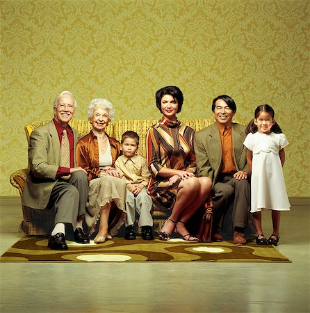 Three generation family sitting in sofa Stock Photo - Rights-Managed, Code: 877-06834173