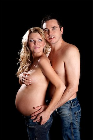 Man embracing topless pregnant woman Stock Photo - Rights-Managed, Code: 877-06834260