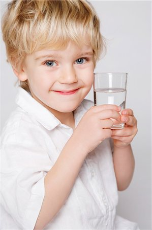 drinking water glass - little boy glass of water Stock Photo - Rights-Managed, Code: 877-06835032