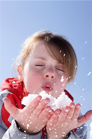 France, winter girl portrait blowing snow Stock Photo - Rights-Managed, Code: 877-06835760