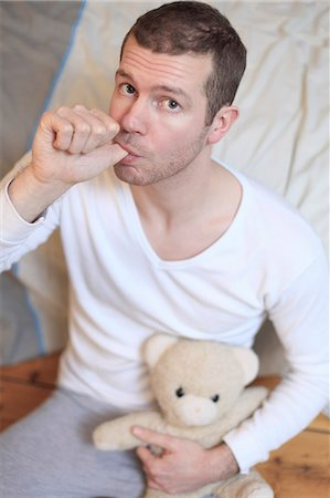 sucking - France man at home.Teddy bear. Stock Photo - Rights-Managed, Code: 877-06835876