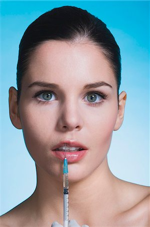 Young woman with syringe on lips Stock Photo - Rights-Managed, Code: 877-06836280