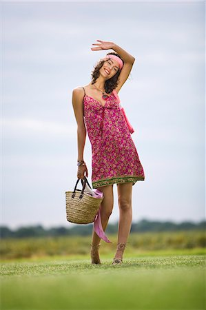 Young woman on grass, oudoors Stock Photo - Rights-Managed, Code: 877-06832304
