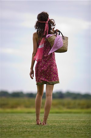 Young woman on grass, rear view, oudoors Stock Photo - Rights-Managed, Code: 877-06832301
