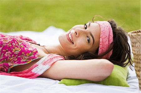 Young woman smiling, lying, oudoors Stock Photo - Rights-Managed, Code: 877-06832314
