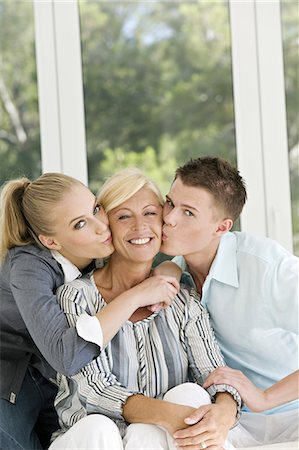 Young couple kissing mature woman Stock Photo - Rights-Managed, Code: 877-06832449