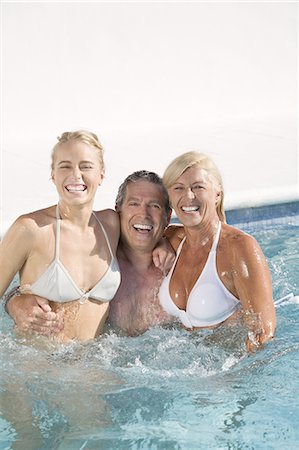 Mature couple and young woman in a pool, smiling Stock Photo - Rights-Managed, Code: 877-06832487