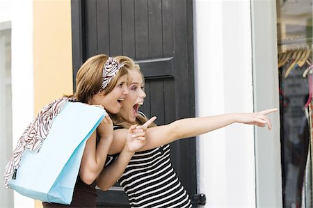 Two young women looking at show window Stock Photo - Rights-Managed, Code: 877-06832535
