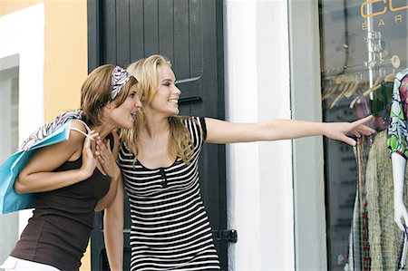 Two young women looking at show window Stock Photo - Rights-Managed, Code: 877-06832536