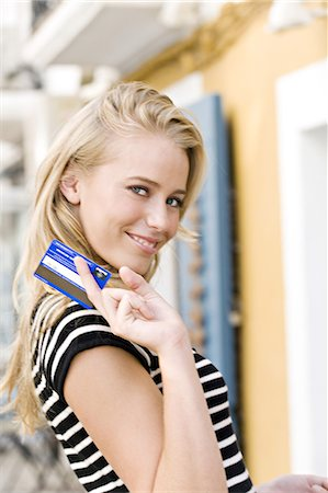 Portrait of a young woman holding a credit card Stock Photo - Rights-Managed, Code: 877-06832540